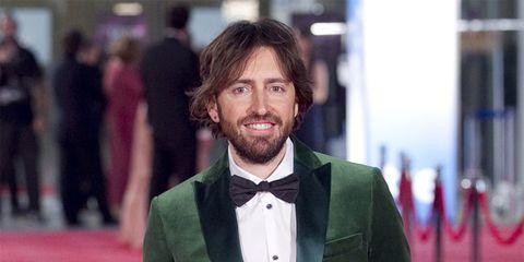 Coat, Facial hair, Hairstyle, Dress shirt, Collar, Shirt, Bow tie, Suit, Outerwear, Formal wear,