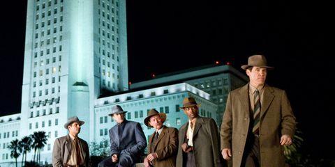 Hat, Suit trousers, Tower, Blazer, Sun hat, Overcoat, Drama, Tower block, Acting, Fedora,