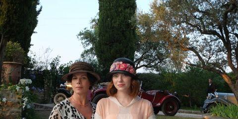 Hat, Tree, Fender, Sun hat, Headgear, Fashion accessory, Motorcycle, Auto part, Garden, Necklace,