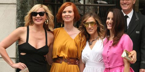 Clothing, Eyewear, Hair, Smile, Glasses, Dress, Outerwear, Sunglasses, Fashion accessory, Facial expression,