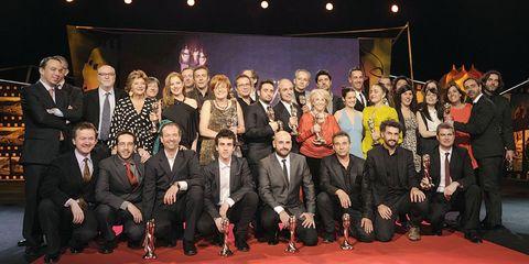 Footwear, Social group, Formal wear, Suit, Team, Blazer, Suit trousers, Carpet, Tuxedo, Dress shoe,
