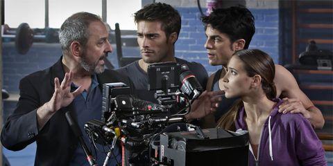 Hair, Face, Head, Video camera, Television crew, Camera operator, Videographer, Filmmaking, Camera, Journalist,
