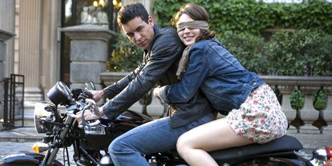 Motorcycle, Video camera, Camera, Fender, Jacket, Interaction, Bag, Honeymoon, Luggage and bags, Leather,