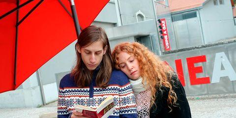 Red, Denim, Street fashion, Reading, Brown hair, Long hair, Publication, Umbrella, Beard, Coquelicot,
