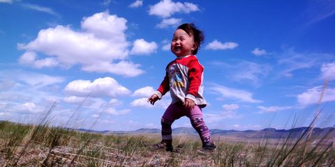 Sky, Happy, Child, People in nature, Baby & toddler clothing, Grassland, Grass family, Toddler, Flash photography, Cumulus,