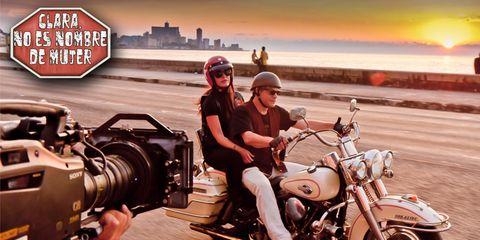 Motorcycle, Automotive design, Automotive tire, Helmet, Fender, Fuel tank, Camera, Video camera, Digital camera, Machine,