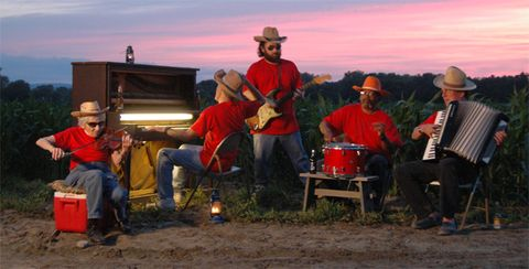 Musical instrument, Musician, Music, Hat, Musical instrument accessory, Band plays, Music artist, Folk instrument, Free reed aerophone, Artist,