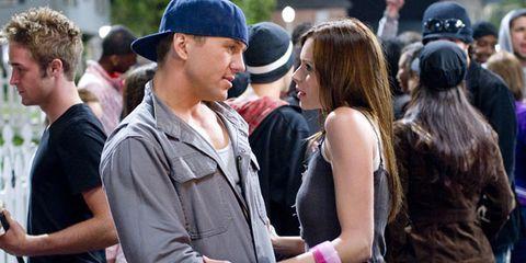 Arm, Cap, Hat, Crowd, Interaction, Baseball cap, Jacket, Street fashion, Belt, Journalist,