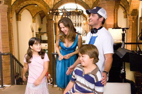 Arm, Cap, Eye, Child, Dress, Arch, Baseball cap, One-piece garment, Beard, Family,