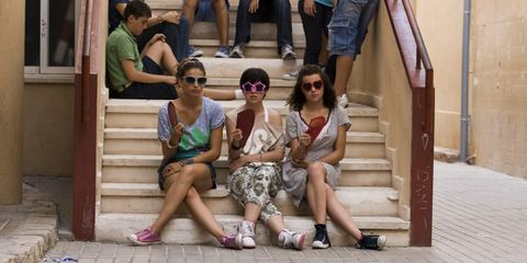 Clothing, Eyewear, Leg, Vision care, Glasses, Human leg, Trousers, Sunglasses, Sitting, Stairs,
