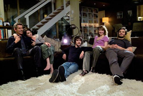 Leg, Lighting, Comfort, Sitting, Living room, Couch, Lap, Shelf, Foot, Family pictures,