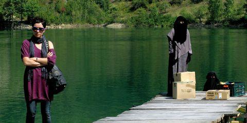 Dock, Sunglasses, Travel, Bag, Lake, Street fashion, Boardwalk, Pier, Deck, Abaya,