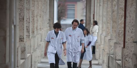 Sleeve, Standing, Street, Street fashion, Temple, Uniform, Knee, Walking, Suit trousers, Ankle,