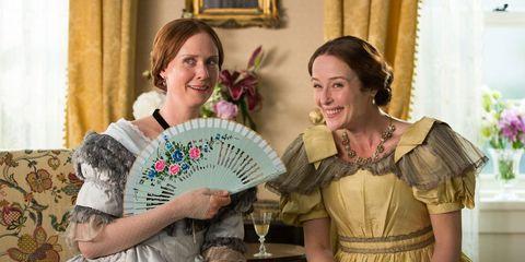 Face, Hand fan, Decorative fan, Happy, Facial expression, Dress, Curtain, Victorian fashion, Tradition, Embellishment,