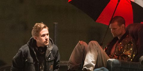 Shoe, Jacket, Umbrella, Conversation, Boot, Leather, Outdoor shoe, Leather jacket, Acting,
