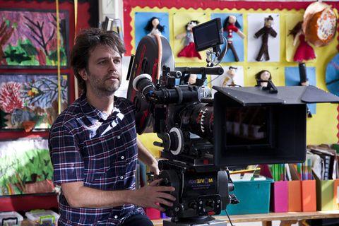 Camera, Cameras & optics, Video camera, Plaid, Camera accessory, Camera operator, Tartan, Filmmaking, Videographer, Film camera,