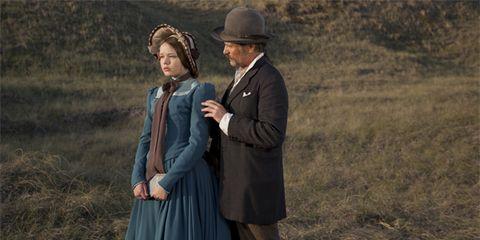 Hat, Photograph, Standing, Formal wear, Coat, Interaction, Collar, Headgear, Dress, Vintage clothing,