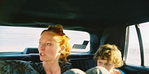 Transport, Passenger, Comfort, Mammal, Vehicle door, Car seat, Sitting, Travel, Head restraint, Car seat cover,
