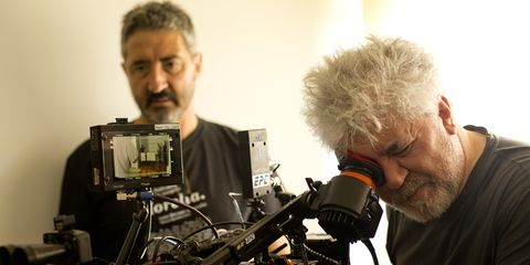 Facial hair, Video camera, Cameras & optics, Television crew, Filmmaking, Camera operator, Videographer, Beard, Film camera, Film crew,