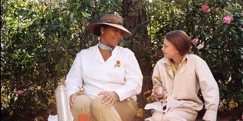 Hat, Sitting, People in nature, Sun hat, Vintage clothing, Suit trousers, Fedora,