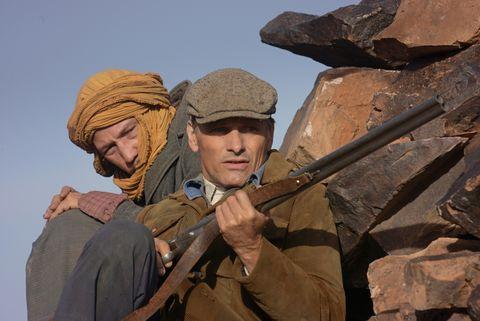 Soldier, Headgear, Cap, Khaki, Helmet, Military uniform, Military person, Turban, Air gun, Ballistic vest,