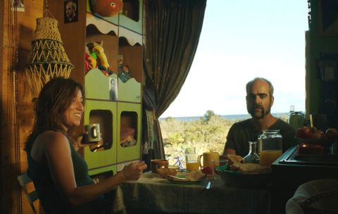 Sharing, Curtain, Drink, Window treatment, Conversation, Beard, Plate, Wine glass, Serveware, Window valance,