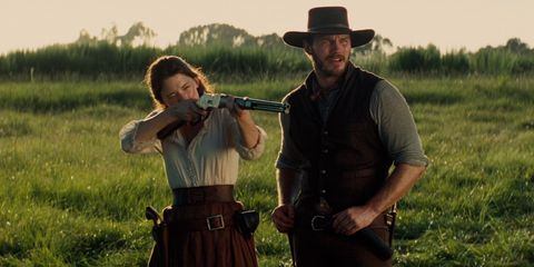 Hat, Wind instrument, Sun hat, Grassland, Shotgun, Woodwind instrument, Facial hair, Fedora, Belt, Prairie,