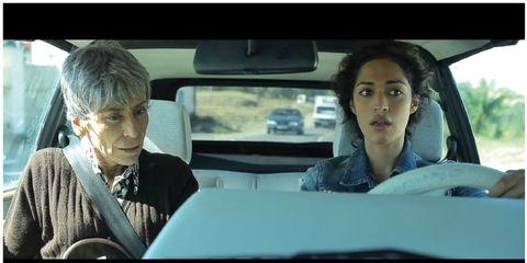 Motor vehicle, Car seat, Vehicle door, Automotive mirror, Automotive exterior, Glass, Head restraint, Black hair, Windshield, Rear-view mirror,