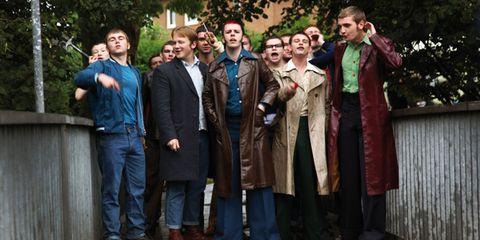 Social group, Denim, Temple, Jacket, Overcoat, Costume, Vintage clothing, Boot,