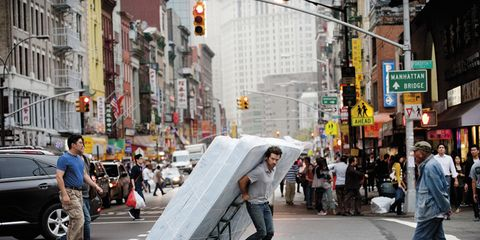 Footwear, Road, Street, Infrastructure, Road surface, Neighbourhood, Pedestrian, Urban area, Jeans, Building,