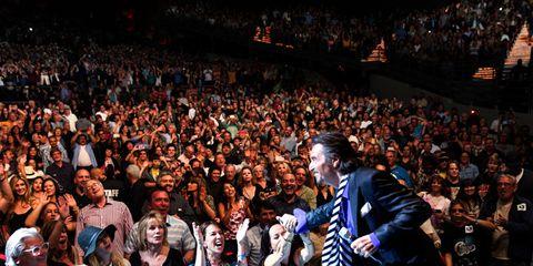Crowd, Audience, Fan, Public event, Concert, Convention, Stadium, Guitarist, Backpack, Arena,