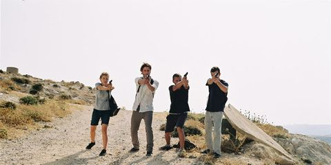 Trousers, People in nature, T-shirt, Tourism, Travel, Bedrock, Outdoor shoe, Outcrop, Badlands,