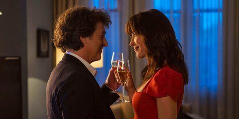 Wine glass, Stemware, Drink, Coat, Dress, Suit, Formal wear, Drinkware, Interaction, Glass,