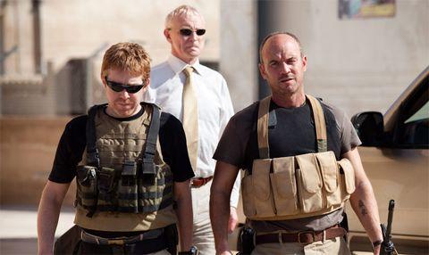 Eyewear, Vision care, Sunglasses, Collar, Uniform, Ballistic vest, Khaki, Belt, Picture frame, Law enforcement,