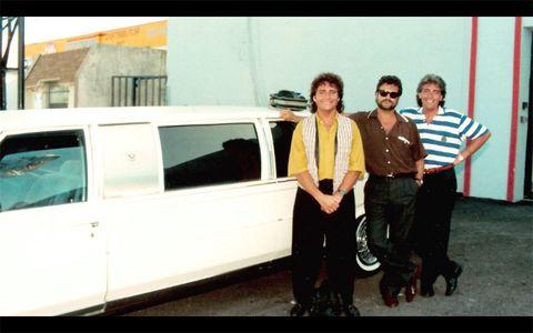 Photograph, Vehicle door, Flag, Teal, Photography, Street fashion, Turquoise, Snapshot, Classic, Luxury vehicle,