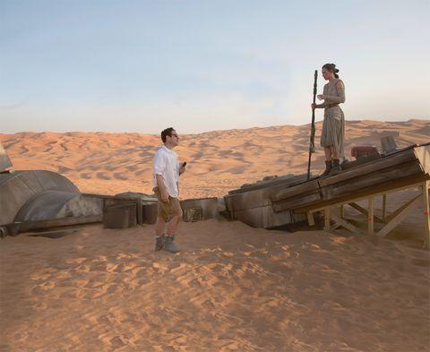 Natural environment, Sand, Landscape, Aeolian landform, Standing, Tent, Ecoregion, Desert, Vacation, Khaki,