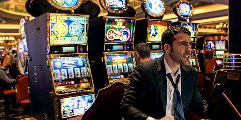 Lighting, Machine, Slot machine, Tie, Arcade game, Games, Blazer, Technology, Casino, Display device,
