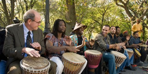 Drum, Musical instrument, Membranophone, Djembe, Musician, Hand drum, Hat, Percussion, Percussionist, Band plays,