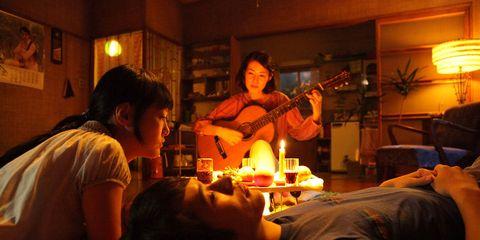 Lighting, Comfort, Room, String instrument, Guitar, Plucked string instruments, Acoustic guitar, String instrument, Lamp, Houseplant,