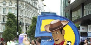 Hat, Costume accessory, Costume hat, Human settlement, Pedestrian, Costume, Boot, Mascot, Sculpture, Animation,