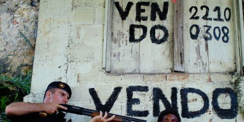 T-shirt, Font, Handwriting, Paint, Shooting, Graffiti, Air gun, Street art, Shotgun, Baseball cap,