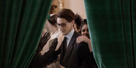 Glasses, Coat, Formal wear, Suit, Tie, Curtain, Tuxedo, Ceremony, Bow tie,