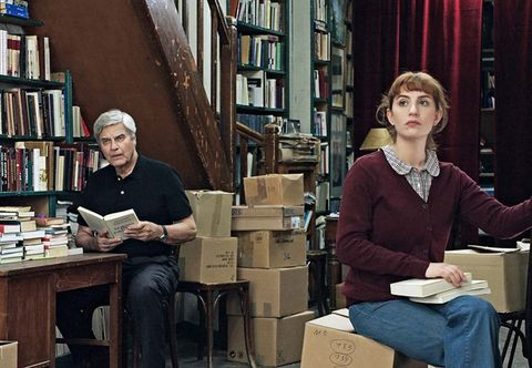 Library, Conversation, Librarian, Bookselling, Sitting, Public library, Book, Bookcase,