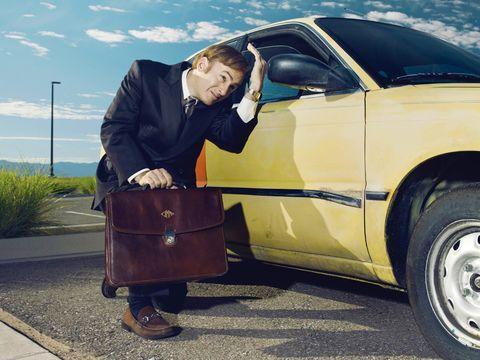 Clothing, Tire, Automotive tire, Brown, Automotive design, Vehicle, Vehicle door, Rim, Outerwear, Bag,
