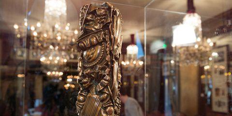 Metal, Sculpture, Light fixture, Bronze, Collection, Brass, Transparent material, Carving, Bronze sculpture, Antique,