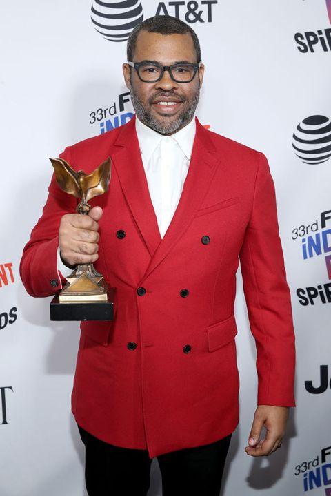 Suit, Outerwear, Formal wear, Tuxedo, Facial hair, Carpet, Drink, Award ceremony,