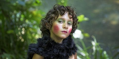 Iris, Fur clothing, Fur, Portrait photography, Natural material, Animal product, Fashion model, Embellishment, Portrait,