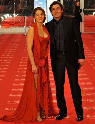 Coat, Red, Suit, Outerwear, Flooring, Dress, Formal wear, Carpet, Style, Premiere,