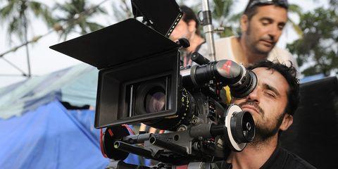 Camera, Video camera, Hand, Cameras & optics, Camera operator, Videographer, Film camera, Camera accessory, Lens, Television crew,