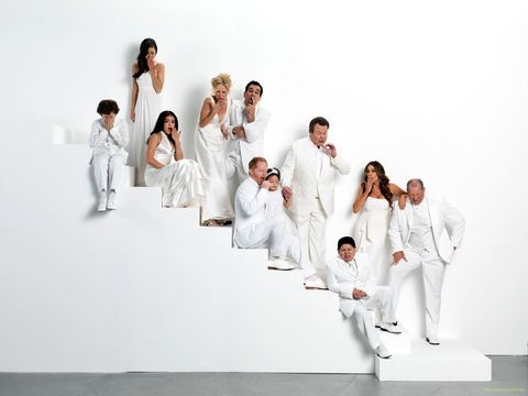 People, Sleeve, Social group, White, Sitting, Suit trousers, Fashion design, Wedding dress, Collaboration,